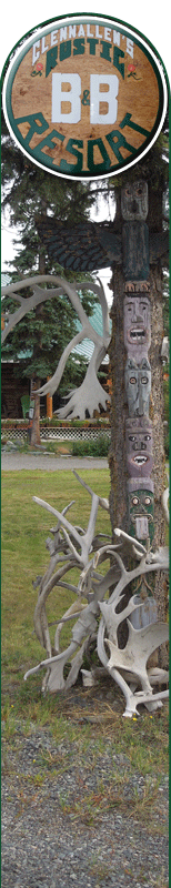 Exterior of B and B with caribou shed and totem pole decorations